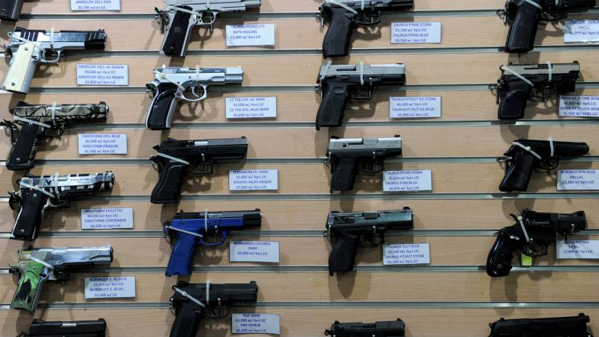 Firearms are showcased at a busy mall in the Philippine capital the same day.