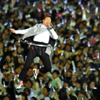 New heights: South Korean singer Psy performs at a concert in Seoul on Saturday. | AFP-JIJI