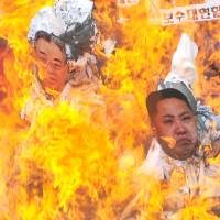 North Korea threatens South after protesters burn effigies of revered leaders