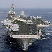 Shipping out: The aircraft carrier USS Kitty Hawk sails with U.S. and Japanese naval vessels in November 2007. China announced plans Tuesday to build a new generation of carriers. | BLOOMBERG