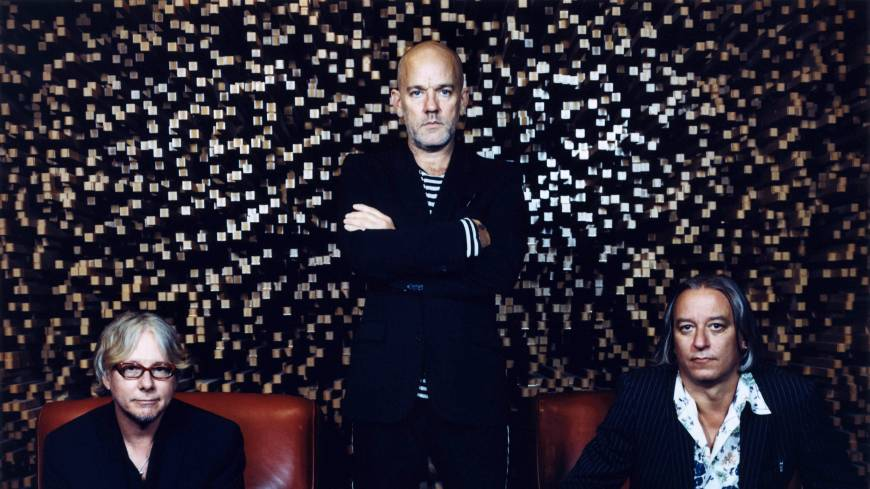 Starting an end: The U.S. band R.E.M. (from left, Mike Mills, Michael Stipe and Peter Buck), who wrote the 1987 song 'It's the End of the World as We Know It (And I Feel Fine)' with former drummer Bill Berry, may have called it quits in September 2011, but books using the title 'The End of ...' seem to have no end, Carlos Lozada asserts.