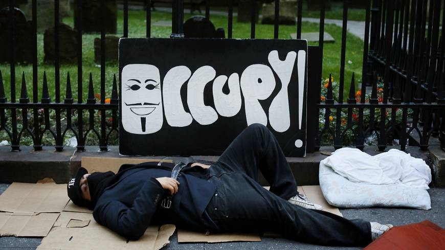 Put to bed: An Occupy Wall Street protester sleeps on the ground before a demonstration in New York on Sept. 17, 2012.