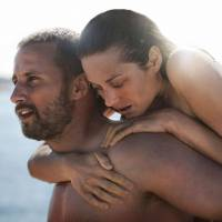 Triumphant in love: A complex relationship unfolds between bare-knuckle fighter Ali (Matthias Schoenaerts) and freshly disabled Stephanie (Marion Cotillard) in 'Rust and Bone.' | © WHY NOT PRODUCTIONS — PAGE 114 — FRANCE 2 CINEMA — LES FILMS DU FLEUVE — LUNANIME