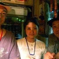 Big smiles for sake: Smile Nihonshu producer Hacchaku Ono (left) with staff members Mana Tanaka (center) and 'Jungle' Hayashi at Bar Open in Shinjuku, Tokyo. | MELINDA JOE PHOTO