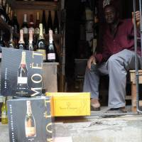 Bubble economy: Champagne on sale at a roadside shop in Lagos. Recent data has shown Nigeria to be among the fastest-growing countries in the world for Champagne consumption. | AFP-JIJI