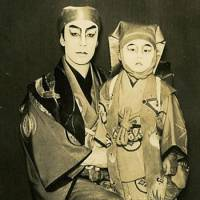 Child prodigy: Matsumoto Koshiro IX is shown here at the age of 3 (when he was known as Matsumoto Kintaro II), with his father, Matsumoto Koshiro VIII. The photo records the first occasion on which father and son performed on stage together — at the Tokyo Gekijo in May 1946. Today's kabuki star recalls of that time that, 'After my makeup was done I would run crying to my mother, and of course the makeup would all get in a mess and my mother's kimono would get in a mess.' | MATSUMOTO KOSHIRO OFFICE
