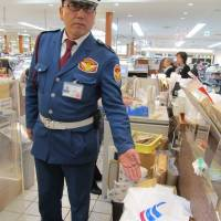 Downing tools: Security guard Naoki Tani points to the spot where former All Black Jerry Collins put down the knives he had carried into the Entetsu department store in Hamamatsu, Shizuoka Prefecture. | SIMON SCOTT