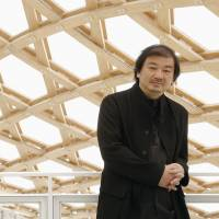 Hats off: Architect Shigeru Ban at the opening in France of his Chinese-headgear-inspired Centre Pompidou-Metz in May, 2010. | KYODO