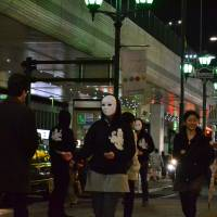 When in Roppongi, tout: Members of the Goldman Sachs Japan union hand out Vampire Squid money in Tokyo's Roppongi district. | COURTESY OF LANGLEY ESQUIRE