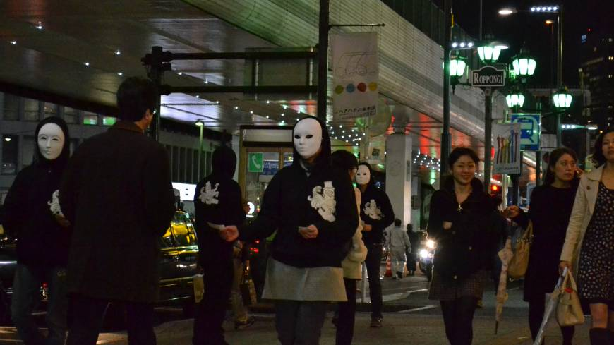 When in Roppongi, tout: Members of the Goldman Sachs Japan union hand out Vampire Squid money in Tokyo's Roppongi district.