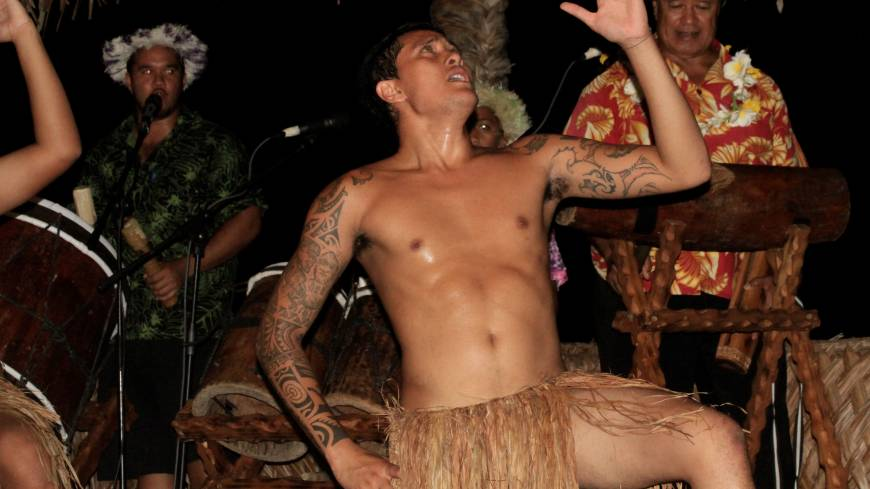 Beat that!: Musicians drum up the past for a traditional dancer at Highland Paradise on Rarotonga.