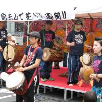 Block party: People shop and musicians play at last year's Kakuozan Spring Festival.