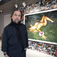 Supermodel-maker: Photographer Sante D'Orazio prefers film over digital photography, which he feels takes away from the sensuality of his subjects. | AFP-JIJI