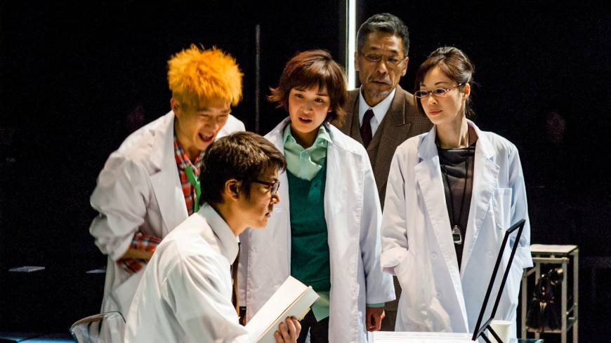 Mr. Efficiency: Ken (Kosuke Toyohara, front) explains the logic of business operation efficiency to two young scientists, chief officer Grant (Suu Nakajima, at rear) and senior scientist Iffy (Yuko Miyamoto, right) in 'The Opportunity of Efficiency.'