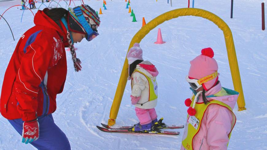 Different strokes: Before trying the Snow Park in front of Appi Kogen Snow Resort's main tower, splendidly kitted-out kids give their divided attention to one of its many instructors.