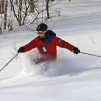 Instructor-guide Tomo Shuhama shows his fine style on an ungroomed and testing slope.   CHRISTOPHER JOHNSON PHOTO