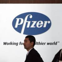 A man walks past Pfizer Inc.'s headquarters in Tokyo on Feb. 13, 2007. | BLOOMBERG PHOTO
