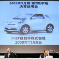 Rough road: Toyota Motor Corp. Executive Vice President Mitsuo Kinoshita (left) and Senior Managing Director Teiji Tachibana attend a news conference Thursday in Tokyo to explain the automaker's projections for the full year. | KYODO PHOTO