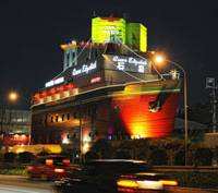 Roaring trade: Cars speed past the Queen Elizabeth Sekitei, a love hotel where couples can rent rooms for as little as two hours, on the outskirts of Tokyo on April 20. | BLOOMBERG PHOTO