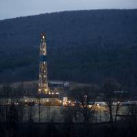 Yen for drilling: A natural gas well is drilled near Canton, Pennsylvania, on Jan. 8, 2012. Japanese trading firms are preparing to import shale gas from the United States to ease skyrocketing procurement costs for liquefied natural gas amid a weakening yen. | KYODO/REUTERS