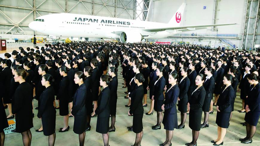 HAPPY LANDINGSNew recruits attend a welcome ceremony Monday in a Japan Airlines Co. hangar at Tokyo's Haneda airport, marking the first new hires at JAL since 2010.