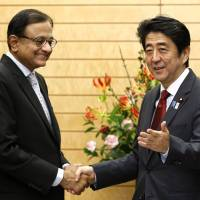 Foundation building: Indian Finance Minister Palaniappan Chidambaram is greeted by Prime Minister Shinzo Abe during his Monday courtesy call at Abe's office in Tokyo. | POOL