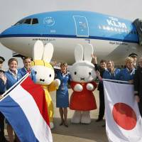 Dutch connection: Cabin and ground crew members of KLM Royal Dutch Airlines pose with Miffy mascots Thursday morning at Fukuoka Airport after the carrier's first direct flight there arrived from Amsterdam. | KYODO