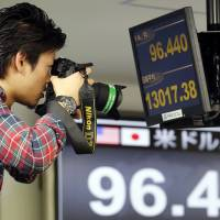 Abe hails BOJ easing steps; Aso cautious on inflation goal
