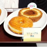 Before and after: Old Mister Donuts products (left) and the new ones are shown to the media Tuesday in the city of Osaka. Duskin Co., operator of the U.S.-founded chain, is changing its donut recipes to cope with sluggish sales. | KYODO