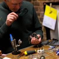 Comeback for DIY: A man fixes a radio at a Restart Project event in north London last month. | AFP-JIJI