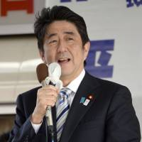 Prime Minister Shinzo Abe stumps for a candidate from his Liberal Democratic Party who is running in the Upper House by-election in Shimonoseki, Yamaguchi Prefecture, on Sunday. | KYODO