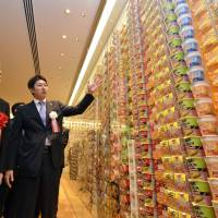 Top ramen: Former Prime Minister Junichiro Koizumi takes in a display of instant noodles from various countries at the 2011 opening of a cup noodle museum in Yokohama. | AFP-JIJI