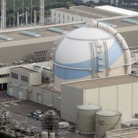 Nothing to see here: Reactor 3 of Kyushu Electric Power Co.'s Genkai nuclear plant in Saga Prefecture is seen in June. | KYODO