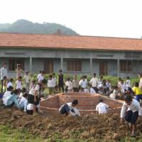 Base for hope: Children build a base for their new school's flagpole in Pailin Province, Cambodia. | COURTESY OF AMATAK HOUSE OF CAMBODIA