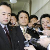 Tax protest: Lower House members leaving the Democratic Party of Japan — (from left) Yasunori Saito, Akira Uchiyama and Atsushi Chugo — face reporters at the Diet on Wednesday. | KYODO