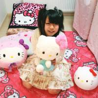 Who dat cat?: Sakumi Otomo, a 17-year-old high school student, hugs a stuffed Hello Kitty at her home in Ebetsu, Hokkaido. | KYODO