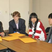 Exchange: Students from Hyogo Prefectural Itami High School talk with Baruch College Campus High School students in New York Thursday at the Japanese Consulate General. | KYODO