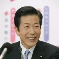 Victorious: New Komeito leader Natsuo Yamaguchi is all smiles Sunday at party headquarters in Shinjuku Ward, Tokyo. | KYODO