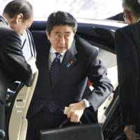Top dog: Prime Minister Shinzo Abe on Thursday arrives at the prime minister's office to meet his new Cabinet. | KYODO