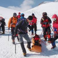 'So that others may live': Rescue personnel hold a drill on Mount Fuji near Gotenba, Shizuoka Prefecture, in February. | SHIZUOKA PREFECTURAL POLICE/KYODO