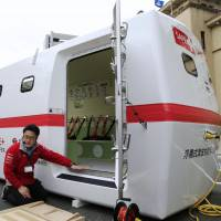 Use in an emergency: A prototype floating tsunami shelter made of fiber-reinforced plastic is shown to the media Thursday at the Shizuoka Prefectural Government offices. The product, manufactured by race car company Tajima Motor Corp., can accommodate up to 20 people. | KYODO