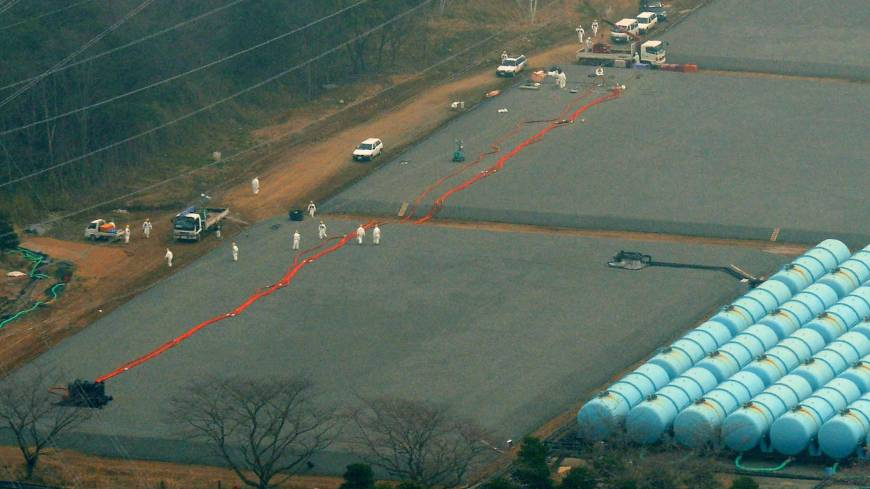 Where did it go?: Workers examine an underground tank Saturday that leaked 120 tons of highly radioactive water at the Fukushima No. 1 nuclear plant in the town of Okuma.