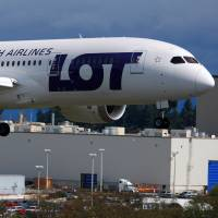 Dream flight?: A Boeing 787 produced for LOT Polish Airlines lands at Paine Air Field Airport in Washington state on Friday after a flight intended to test its new battery system and win approval to take to the skies again from U.S. federal regulators. | AP/THE HERALD