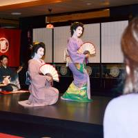 Exclusive event: Female customers watch geisha perform during a women-only group dinner at a traditional high-class restaurant in the city of Kochi last December. | KYODO