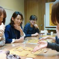 Making a move: Professional 'shogi' player Yamato Takahashi (second from left) teaches techniques and moves during a lesson for women in her 'shogiotome' class in Setagaya Ward, Tokyo, on March 12. Below: Sawako Fukagawa (left) holds the reins of a horse during 'yabusame' (horseback archery) training in Nasushiobara, Tochigi Prefecture, on March 10. | KYODO