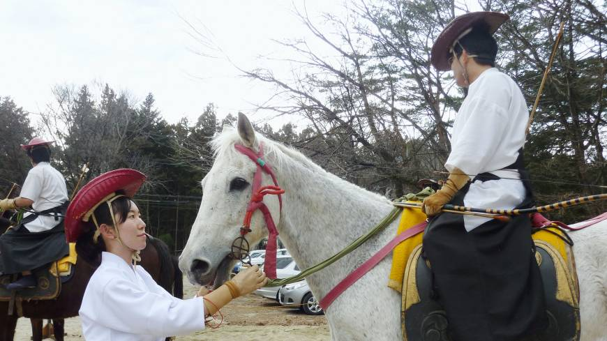 Making a move: Professional 'shogi' player Yamato Takahashi (second from left) teaches techniques and moves during a lesson for women in her 'shogiotome' class in Setagaya Ward, Tokyo, on March 12. Below: Sawako Fukagawa (left) holds the reins of a horse during 'yabusame' (horseback archery) training in Nasushiobara, Tochigi Prefecture, on March 10.