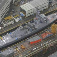 Open the gates: The Japanese Aegis-equipped destroyer Myoko, which might be deployed during a North Korean missile threat, is shown in drydock Sunday in Maizuru port in Kyoto Prefecture. | KYODO