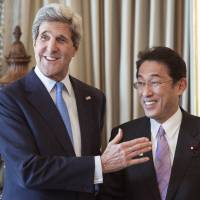 Huddle: U.S. Secretary of State John Kerry greets Foreign Minister Fumio Kishida ahead of their Wednesday meeting in London on the eve of the G-8 Foreign Ministers meeting. | POOL