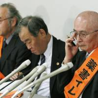 No recourse left: Akio Chikazawa (right), who led a group of plaintiffs in a suit against the Japan unit of British drugmaker AstraZeneca PLC for damages related to deaths from side effects of the firm's cancer drug, faces reporters Friday after the Supreme Court rules against his suit. | KYODO