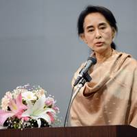 Seeking support: Myanmar opposition leader Aung San Suu Kyi delivers a speech in Tokyo on Saturday to around 1,800 Myanmar nationals currently residing in Japan as the Noble Peace Prize laureate kicked off a weeklong visit at the invitation of the government. | AFP-JIJI